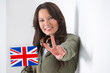 Portrait of a lovely young woman with United Kingdom's flag smil