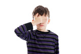 Boy covering his eyes isolated on white