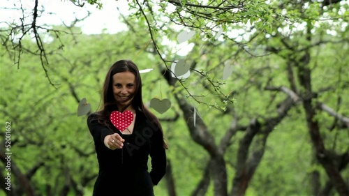 young beautiful girl with a cardboard heart in his hand