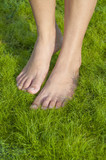 Barefoot walking on grass