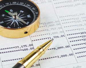Pen and compass on bank account book