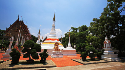 Beautiful white pagodas against shrine and blue sky