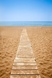 Wooden path to the sandy beach