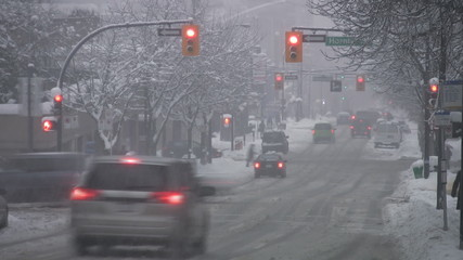 Snowy city intersection. Timelapse. Vancouver, BC.