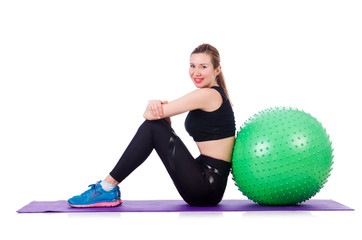 Woman doing exercises with ball on white