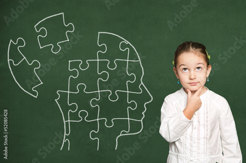 Puzzle in head on chalkboard