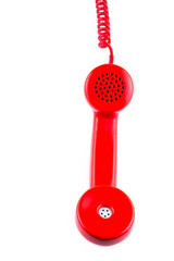 Red telephone receiver on white background.
