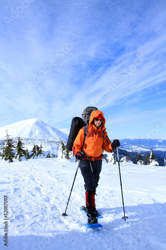 Winter hiking in the mountains on snowshoes.
