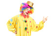 A cheerful clown in a yellow costume