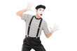 A male mime artist performing