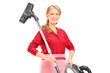 A middle aged female holding a vacuum cleaner