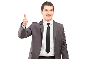 A young businessman giving thumb up