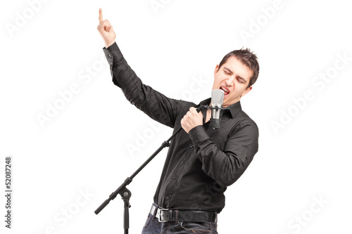 A male singer performing a song