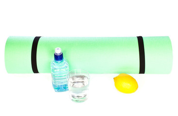 Yoga Mat roll with bottle of wateron white background