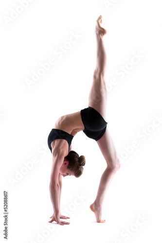 Young flexible brunette posing in studio