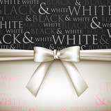 white bow on black and white background