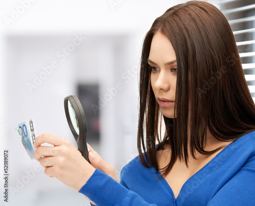 woman with magnifying glass and euro cash money