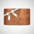 gift card with grunge cardboard texture and white ribbon