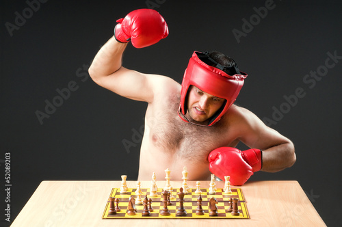 Boxer stuggling with chess game