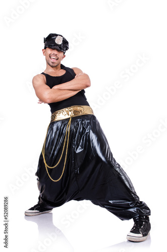 Rap dancer in wide pants on white