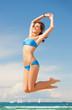 woman in bikini jumping