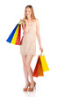 Young woman with colorful shopping bags on white background