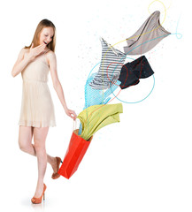 Woman with clothes flying into the bag