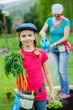 Gardening - young girl helping in the garden