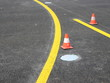 Yellow stripes with traffic cone