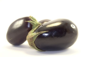 Fresh eggplants on white background