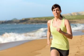 Female athlete running on beach