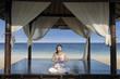 Beautiful yoga woman at luxury beach resort