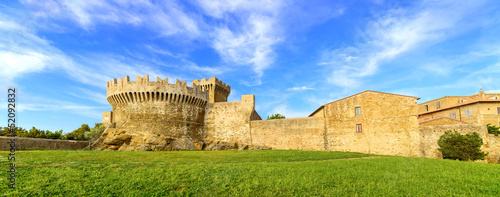 Populonia village landmark, walls and tower. Tuscany, Italy.