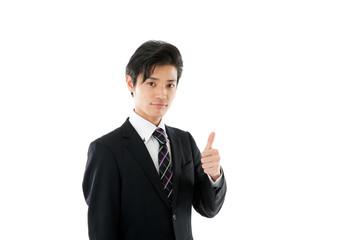 グッドポーズをする若いビジネスマン