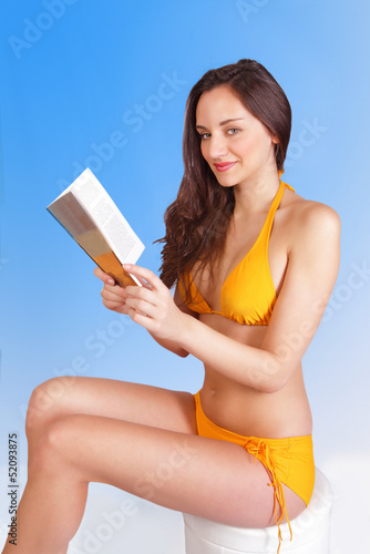Leisure reading girl on beach holiday