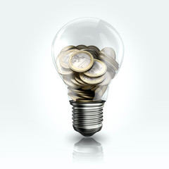 A light bulb with coins  inside