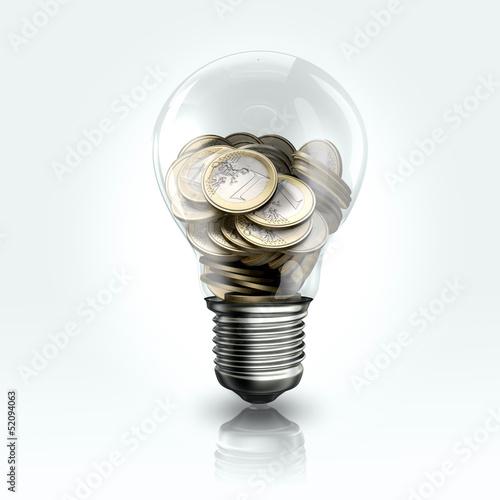 A light bulb with coins  inside