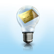 A light bulb with a credit card inside