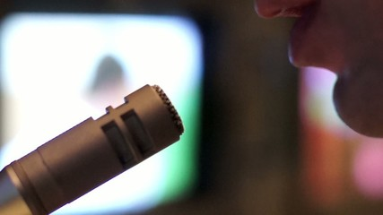 Man talking into a microphone