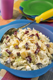 Bowl of coleslaw made with apples, marshmallows and pineapple