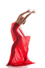 Graceful dancer posing nude with red cloth