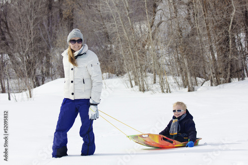 Family enjoying a day Snow sledding