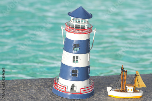 toy lighthouse,toy lighthouse yellow sailboat pool background