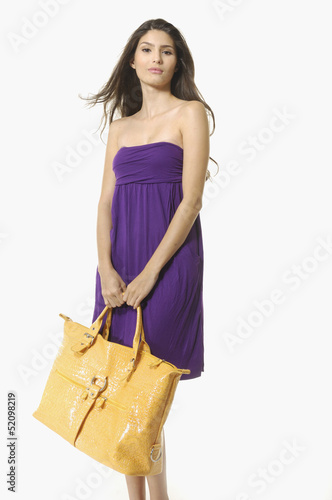 girl with a big bag posing