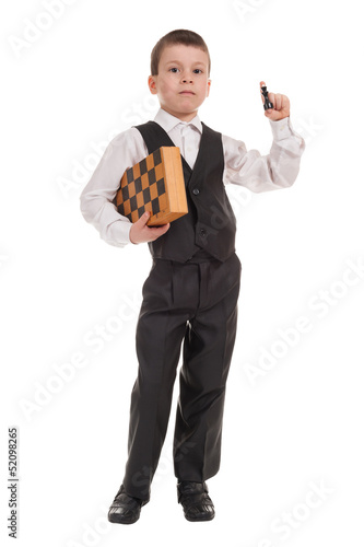 boy in black suit with chess