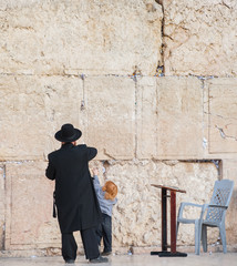 Rabbi and his little son at the Wailing wall, Jerusalem, Israel
