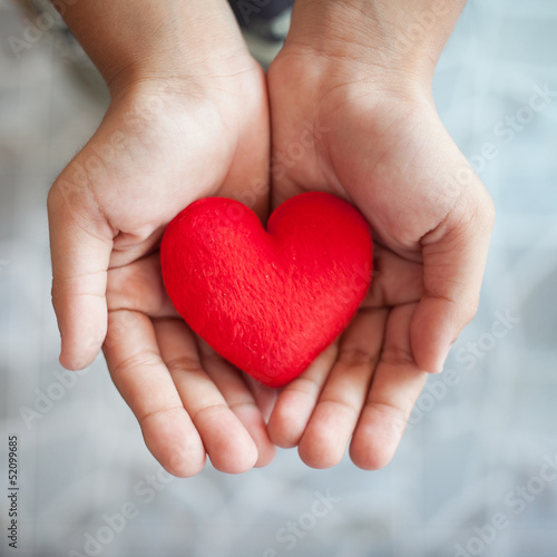 hand and red heart