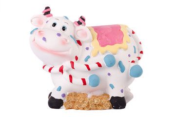 Piggy bank in the form of a cow on a white background