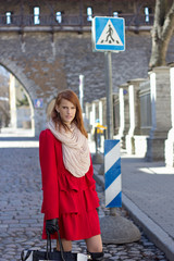 young redhaired woman crossing the street