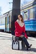 young beautiful woman waiting for train on the platform